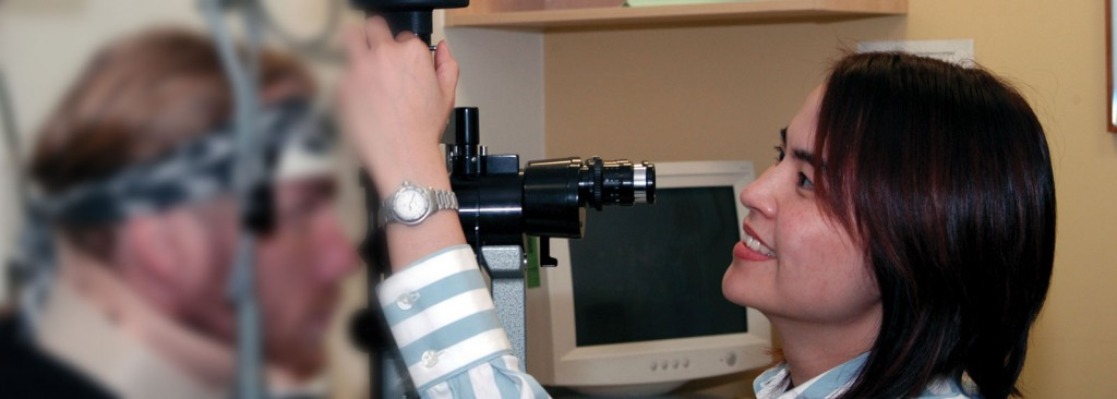 Doctor Wong conducting a slit-lamp eye examination of a patient.